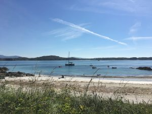 Summer boats and beach Iona